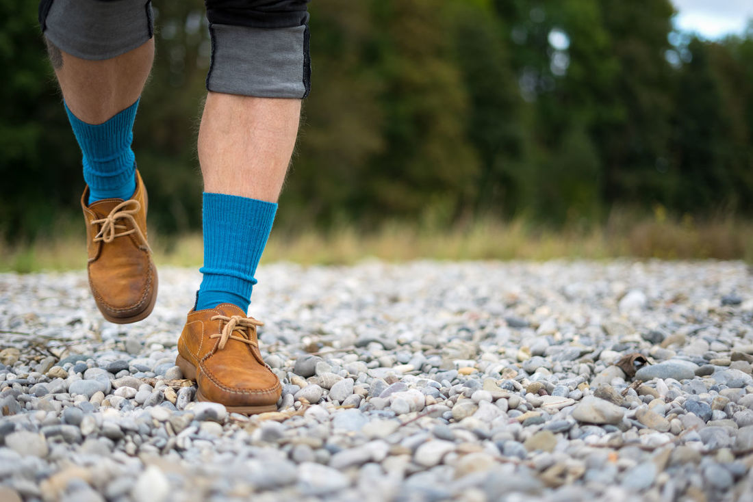 Young man´s legs with blue socks. EyeEm Gallery Riverside Running Taveling Blue Socks Close Up Hiking Boots And Rucksack Hikingadventures Leather Shoes Legs_only Nature_collection River Bank  TrekkingDay Unusual Perspective Walking Alone... Young Man In Jeans Young Man In Nature