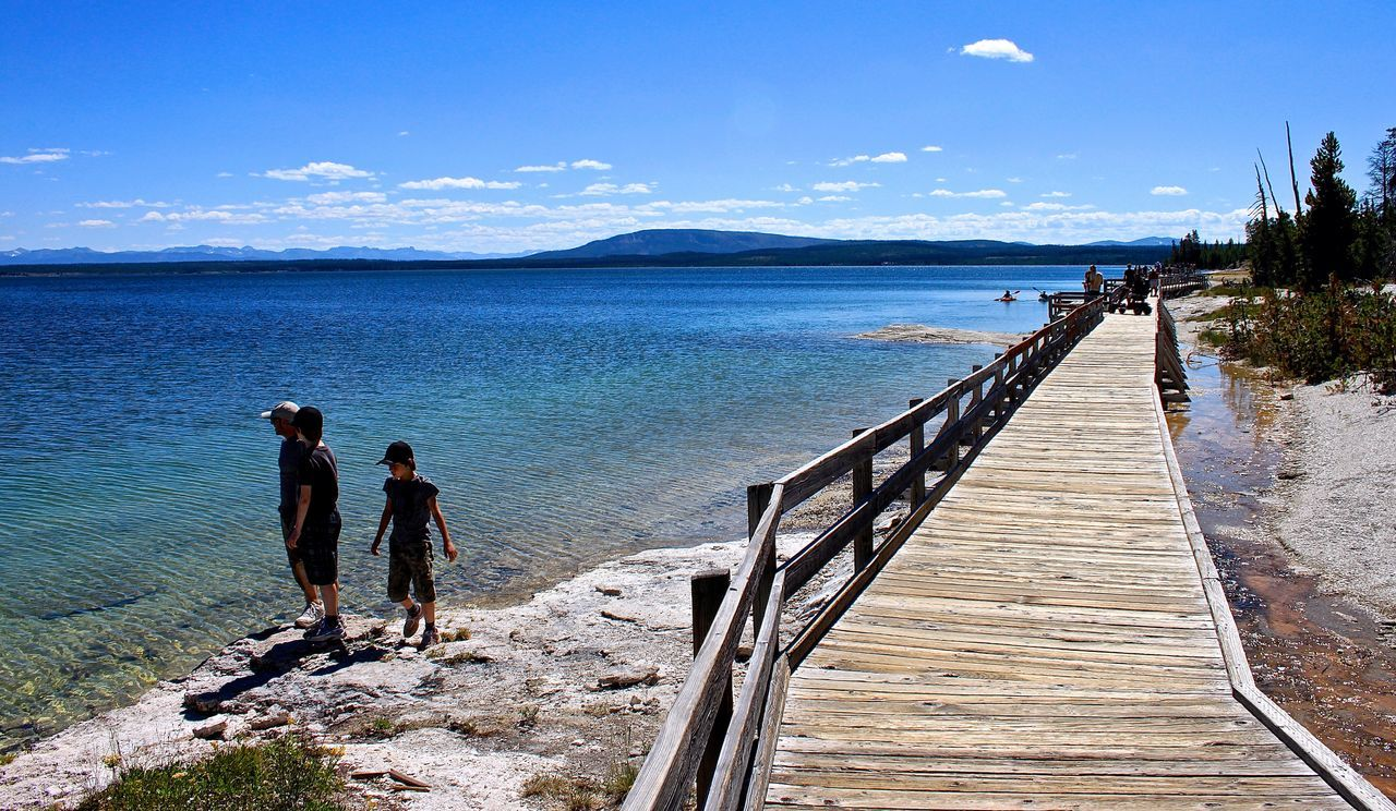 Beauty In Nature Blue Boardwalk Idyllic Leisure Activity Nature Scenics Sky Sunlight The Way Forward Tranquil Scene Tranquility Vacations Water Yellowstone Lake Yellowstone National Park