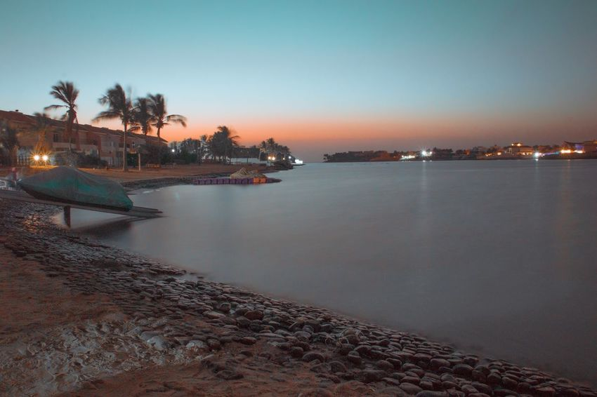 Red Sea Sea Sunset Built Structure Building Exterior Water Nautical Vessel Architecture Dusk Beach Outdoors Sky Clear Sky Moored Nature Beauty In Nature