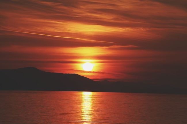 Sunset Orange Color Dramatic Sky Reflection Sea Scenics Nature Beauty In Nature Horizon Over Water Water Outdoors Tranquil Scene No People Sun Tranquility Sunlight Cloud - Sky Landscape Gold Colored Vacations