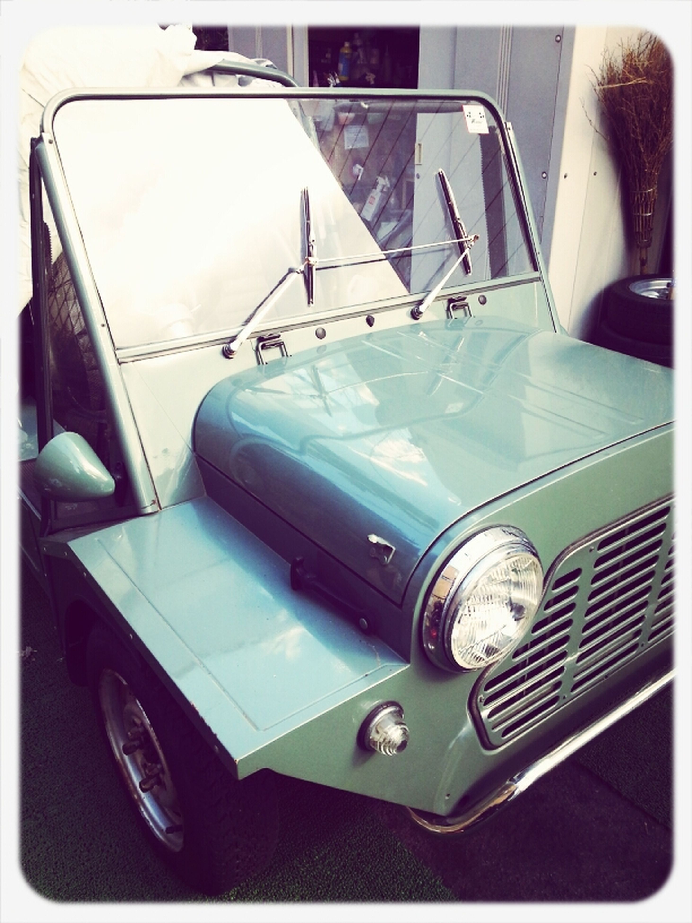 transportation, mode of transport, land vehicle, car, indoors, vehicle interior, technology, transfer print, reflection, high angle view, close-up, travel, connection, auto post production filter, no people, retro styled, day, stationary, part of, old-fashioned