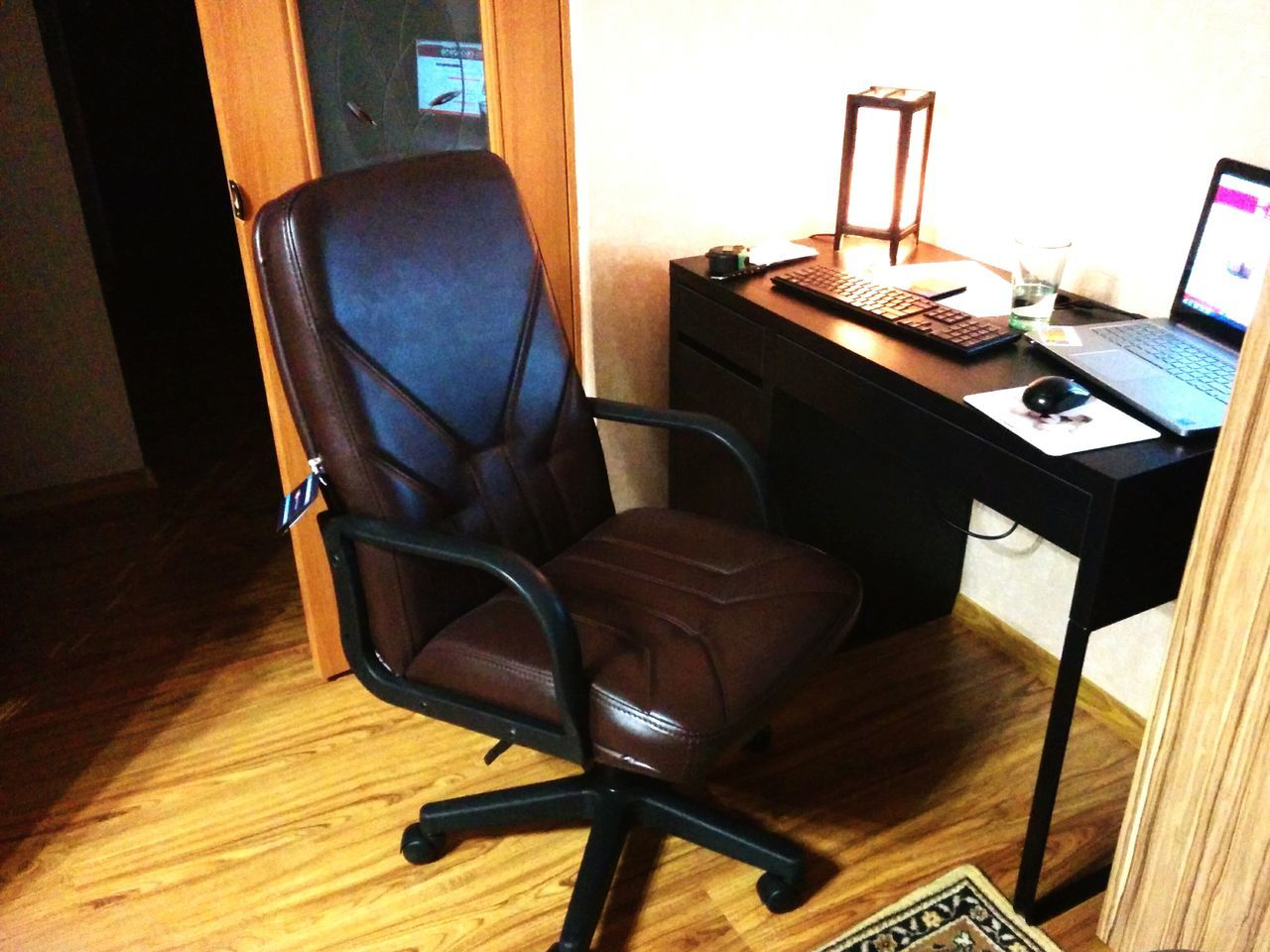 chair, indoors, hardwood floor, technology, home interior, desk, table, furniture, no people, window, wireless technology, office chair, computer, seat, day