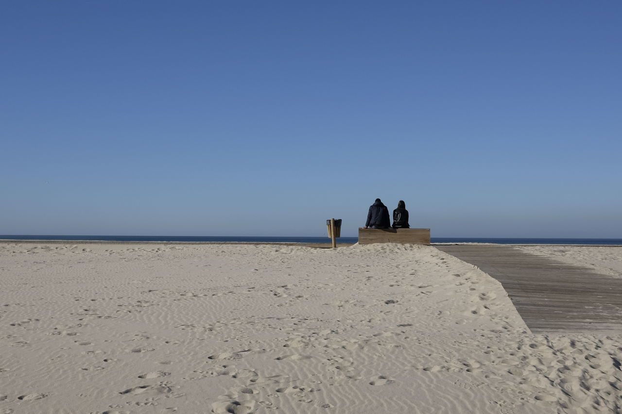 Couple Love Romantic Adult Adults Only Beach Beauty In Nature Blue Clear Sky Day Full Length Horizon Over Water Minimal Minimalism Nature Outdoors Praia Da Costa Nova Rear View Sand Sand Dune Scenics Sea Sky Togetherness Water