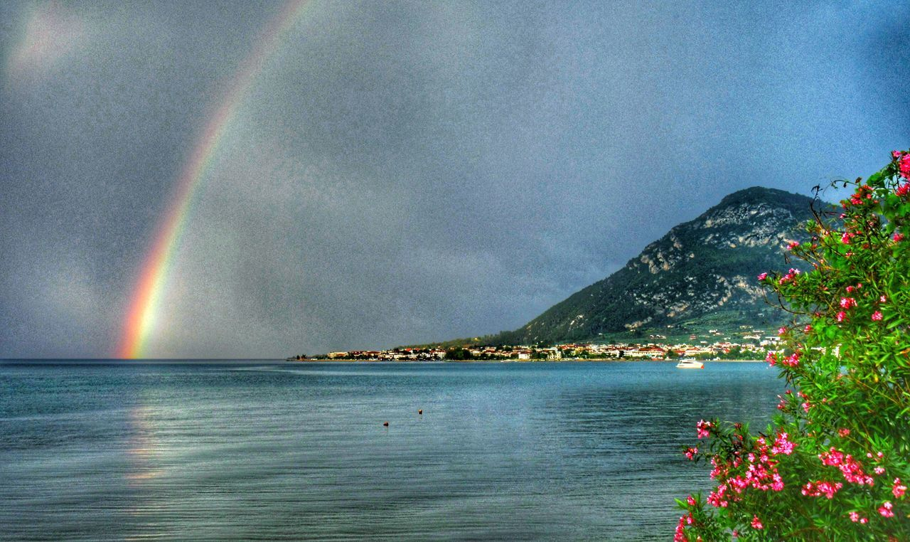 Rainbow and Spring Flowers over the Shore of Kamena Vourla Greece