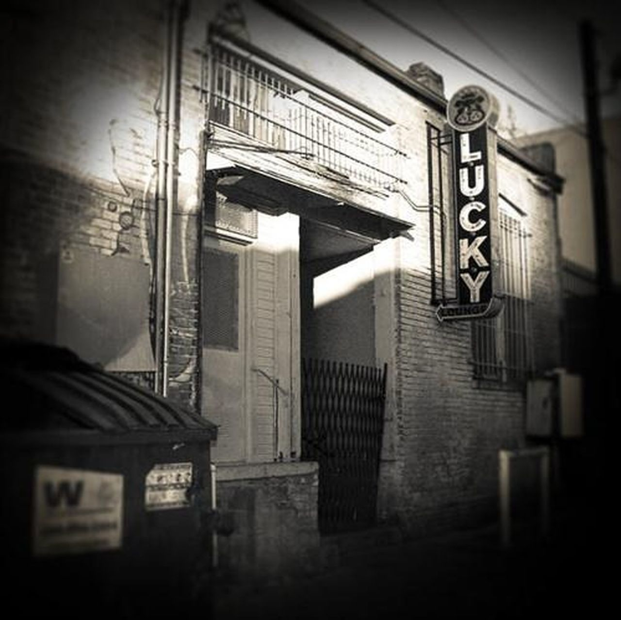 * Web use only (low resolution). Alley Alleyway Austin Bar Black And White City City Life Cityscapes Day Gritty Grungy Lucky Lounge Monotone Square Street Texas Vignette