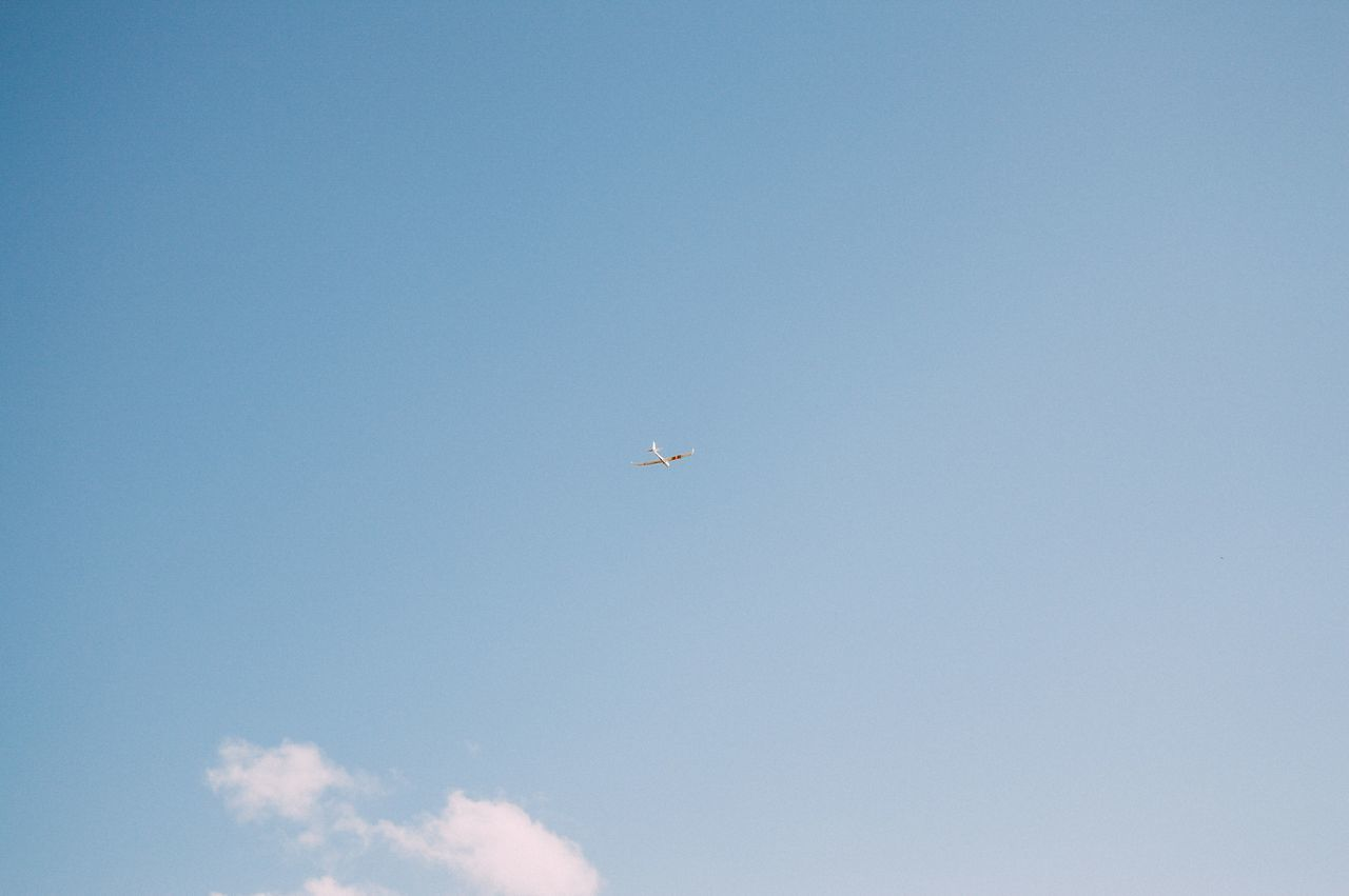 Sky Air Vehicle Airplane Airplane Wing Blue Clear Sky Day Flying Journey Low Angle View Nature No People Outdoors Sky Transportation