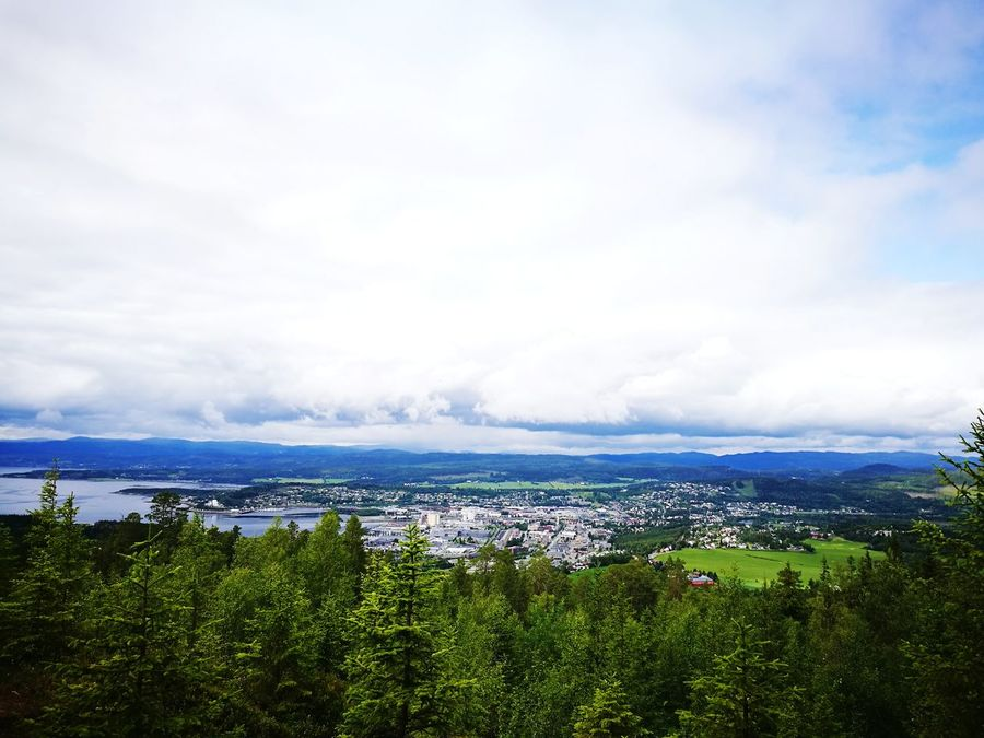 Cloud - Sky Sky Green Color Outdoors Landscape Building Exterior No People Day Nature Horizon Over Water Cityscape City Sea Scenics Grass Architecture Tree Beauty In Nature Norwegian Town Norwegian Landscape Scenic View Town View Nature Woods