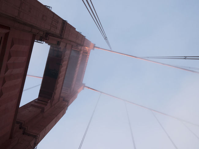 Abstract image of San Fransisco Golden Gate Bridge, looking up. Abstract Abstract Architecture Architecture Built Structure Cable Clear Sky Connection Day Foggy Golden Gate Bridge Horizontal Lookingup Low Angle View No People Outdoors Power Supply Sky Sunlight Tourist Attraction