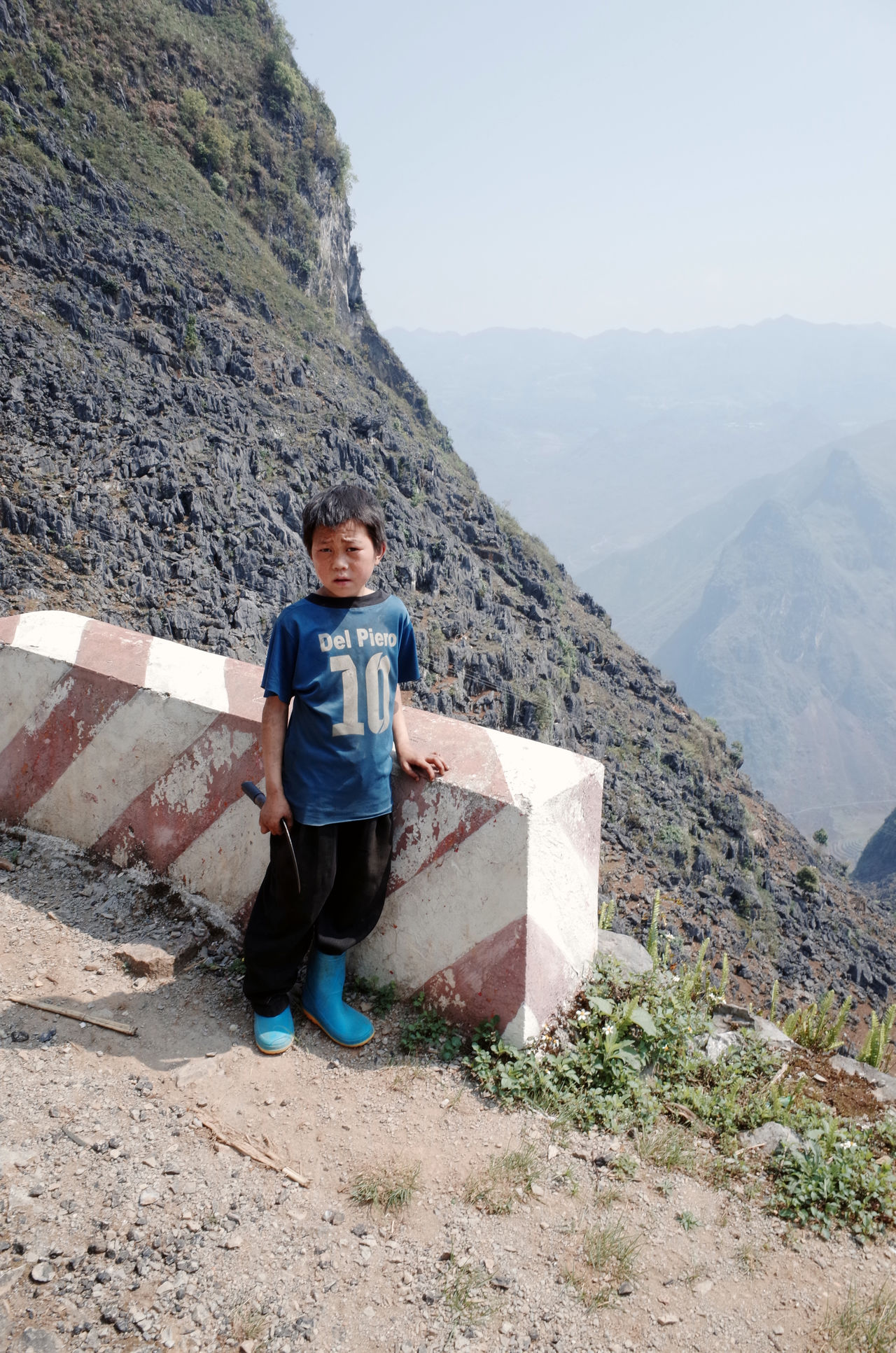 Beauty In Nature Casual Clothing Clear Sky Dirty Ethnic Minorities Full Length Hagiang Kid Landscape Leisure Activity Lifestyles Looking At View Mountain Mountain Range Nature Rear View Scenics Sickle Sitting Sky Standing Tranquil Scene Tranquility Vietnam Working Hard