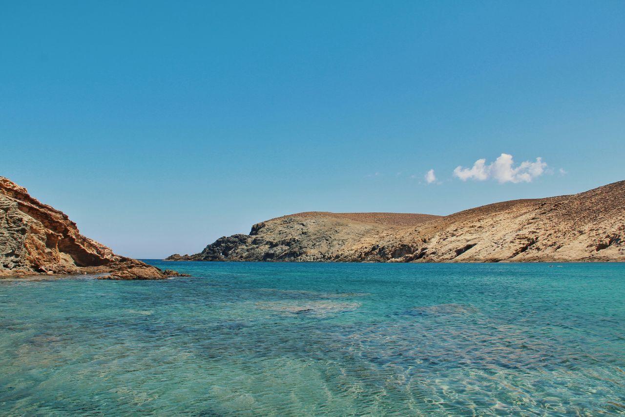 Mykonos sea Landscape Sea Sand Beach Mountain Outdoors No People Sky Day Crystal Clear Waters Mykonos Sea And Sky Clearwater WeekOnEyeEm Best EyeEm Shot Mykonos Island Nature