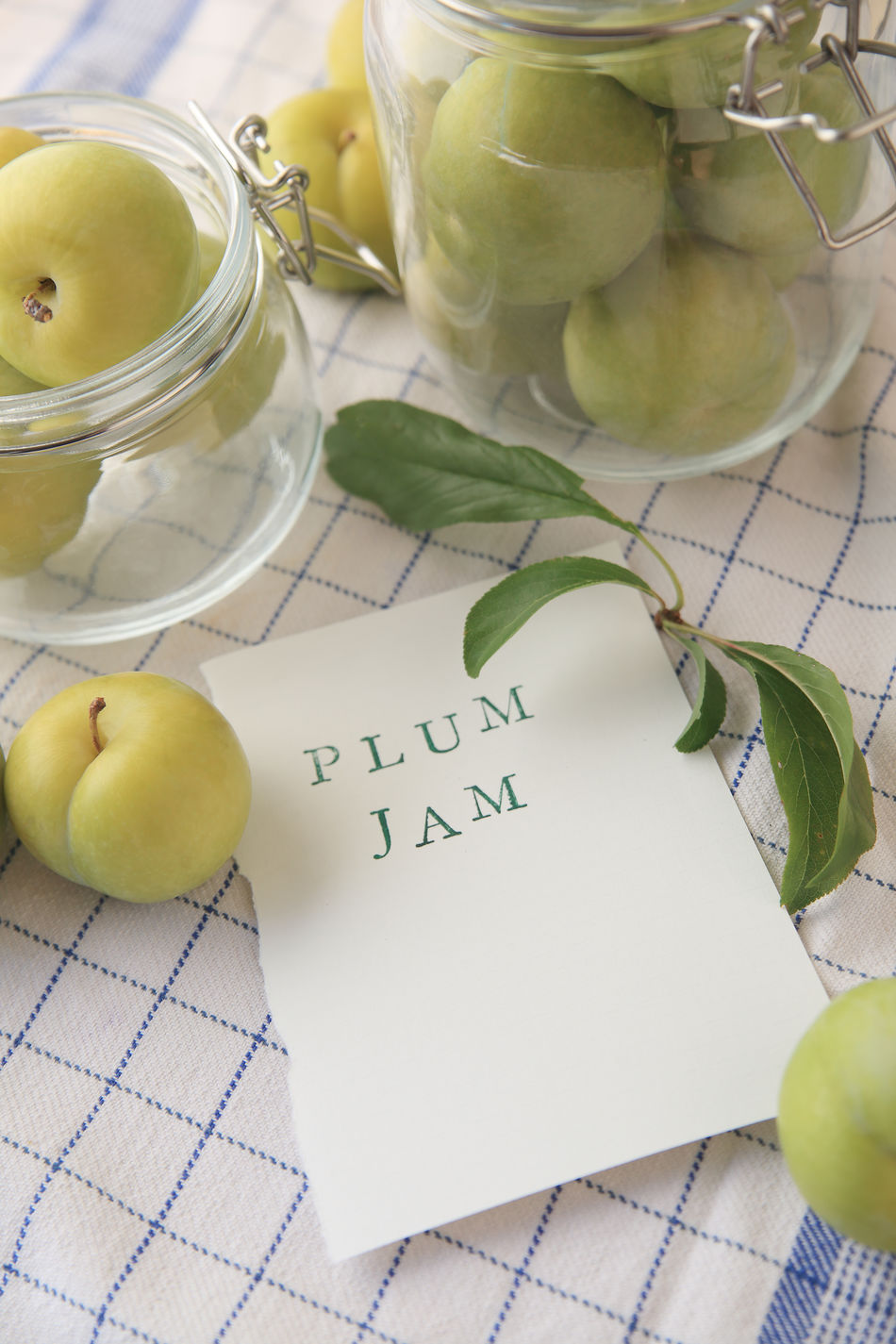 Fresh plums for jam-making in glass jars Closeup Communication Copy Space Dish Towel Foliage Food Preparation Glass Jars Green Color Indoors  Indoors  Leaves Letters Making Jam No People Overhead Paper Pattern Plums Sweet Textures Type Typography Words