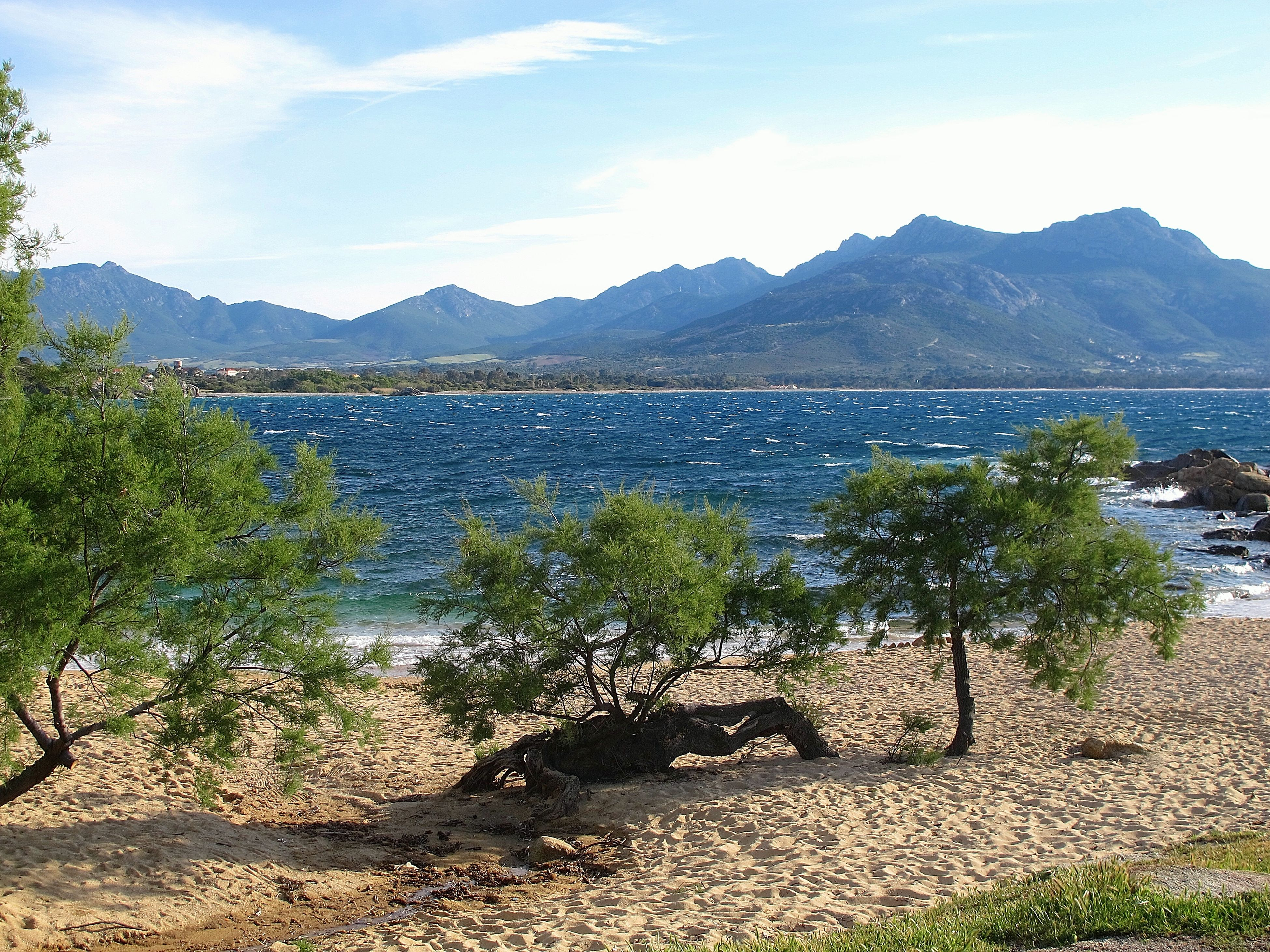 mountain, mountain range, water, tranquil scene, tranquility, scenics, sky, beauty in nature, nature, sea, lake, beach, idyllic, shore, coastline, tree, cloud - sky, non-urban scene, outdoors, cloud