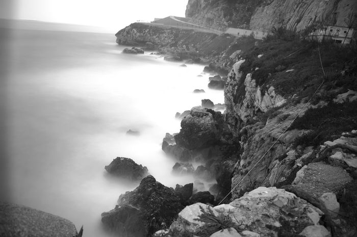 long exposure shot of a rough day at sea Beauty In Nature Calm Cliff Coastline Fog Foggy Geology Idyllic Long Exposure Shot Majestic Mist Mountain Nature Non-urban Scene Outdoors Remote Rock Rock - Object Rock Formation Scenics Sea Tranquil Scene Tranquility Travel Destinations Water