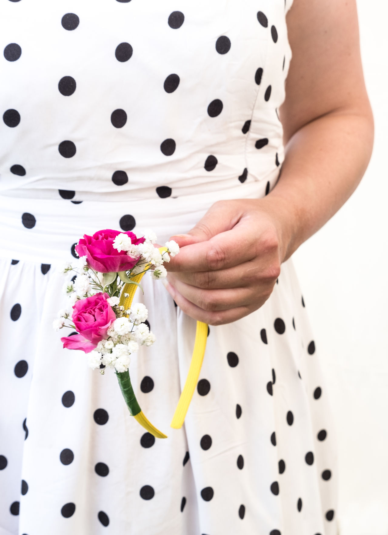 A person holding a floral headband. Carnation Dress Fashion Woman Arm Close-up Fleur Fleur Headband Floral Flowers Hand Headband Holding Human Hand Midsection One Person Pink Flowers Polka Dot Standing Vintage Dress