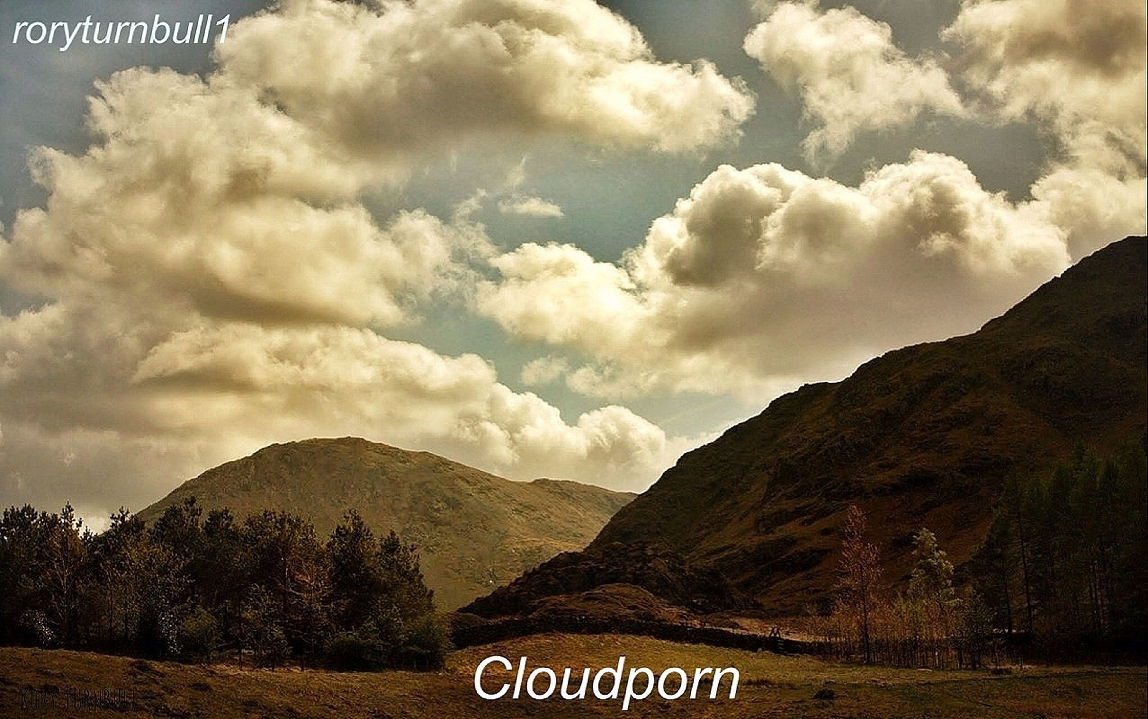 mountain, text, sky, western script, mountain range, communication, tranquil scene, scenics, landscape, tranquility, cloud - sky, beauty in nature, cloud, nature, sign, non-urban scene, cloudy, information sign, day, outdoors
