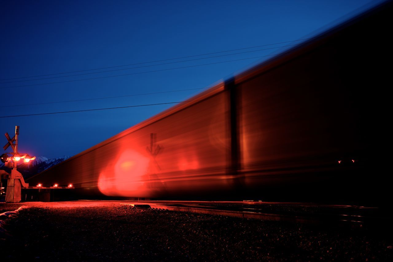 transportation, speed, built structure, mode of transport, train - vehicle, rail transportation, no people, night, outdoors, cable, architecture, red, illuminated, sky
