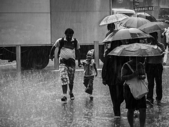 Boy Boy Running City Life Outdoors People Rain Raining Raining Day Street Photography Streetphotography Up Close Street Photography