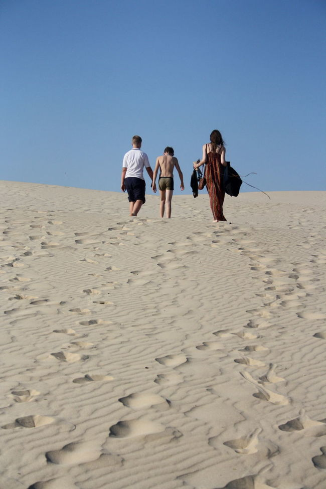 Cousins walking the dunes. Arid Climate Beach Beachphotography Casual Clothing Clear Sky Cousins  Exploration FootPrint Full Length Isolated Leisure Activity Nature Outdoors Person Sand Sand Dune Sandy Sandy Beach Sky Summer Sunlight Tranquility Walking People And Places Dramatic Angles