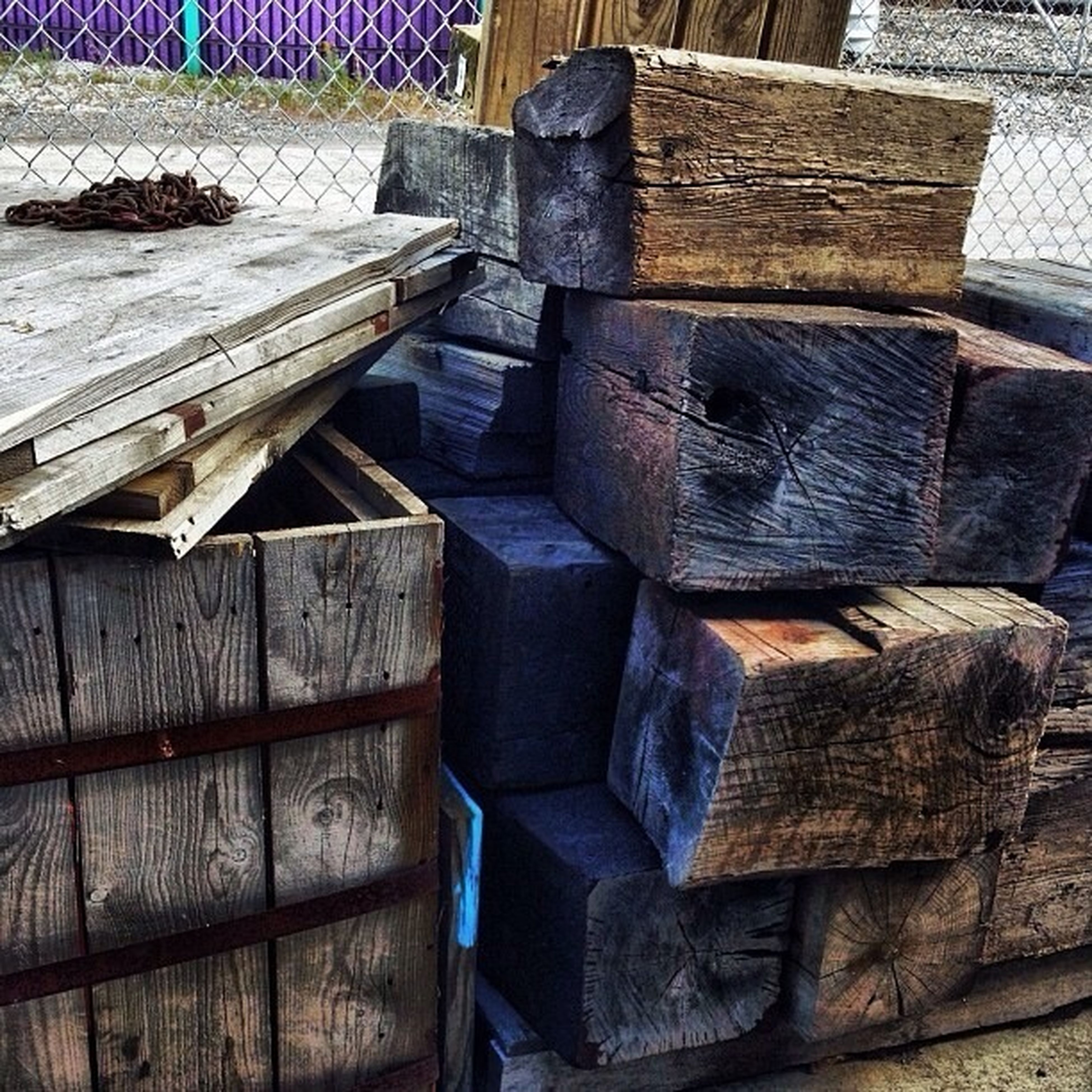 wood - material, large group of objects, high angle view, stack, wooden, wood, abundance, abandoned, old, day, outdoors, no people, obsolete, damaged, chair, in a row, sunlight, log, arrangement, industry