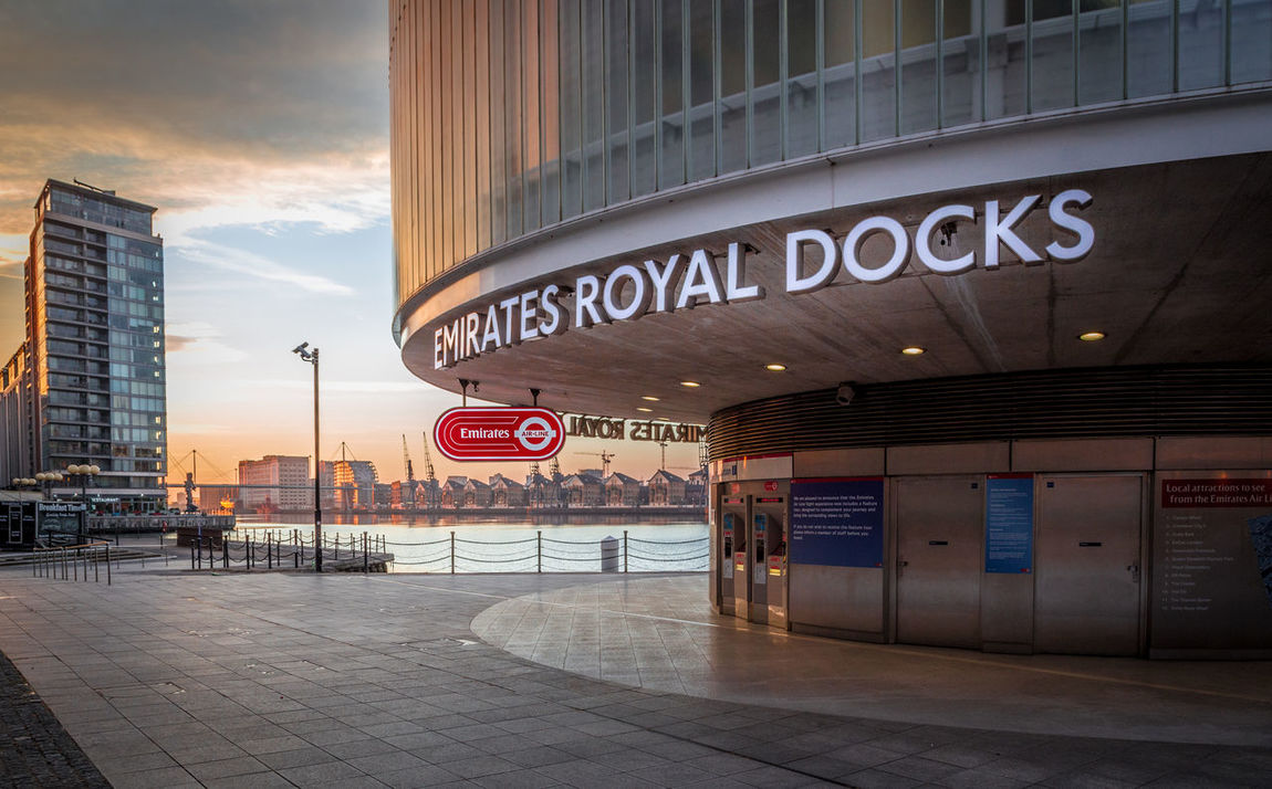 Architecture Building Exterior Built Structure City Communication Day No People Outdoors Road Sign Royal Docks Sky Sunset Text Western Script