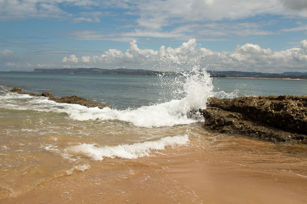 sea, wave, water, beauty in nature, nature, shore, surf, beach, scenics, motion, horizon over water, sky, outdoors, no people, day, force, sand, power in nature