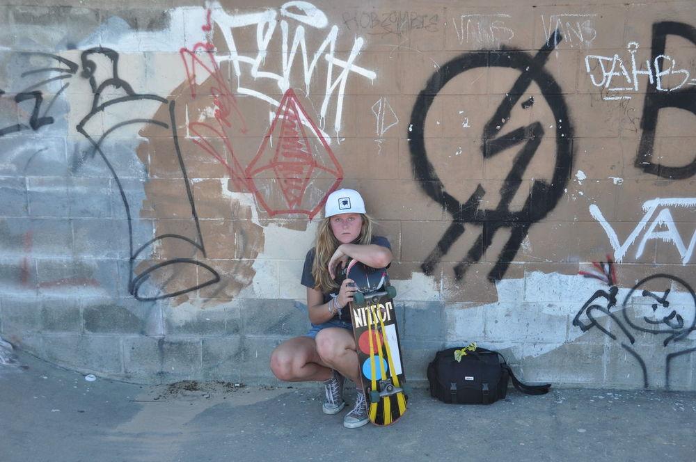 Adventure Club Art Casual Clothing City Color Of Sport Creativity Day Full Length Graffiti Leisure Activity Lifestyles Outdoors Riding Skateboarding Skater Girl Skaterlife Street Art Vandalism Volcomstone Live For The Story