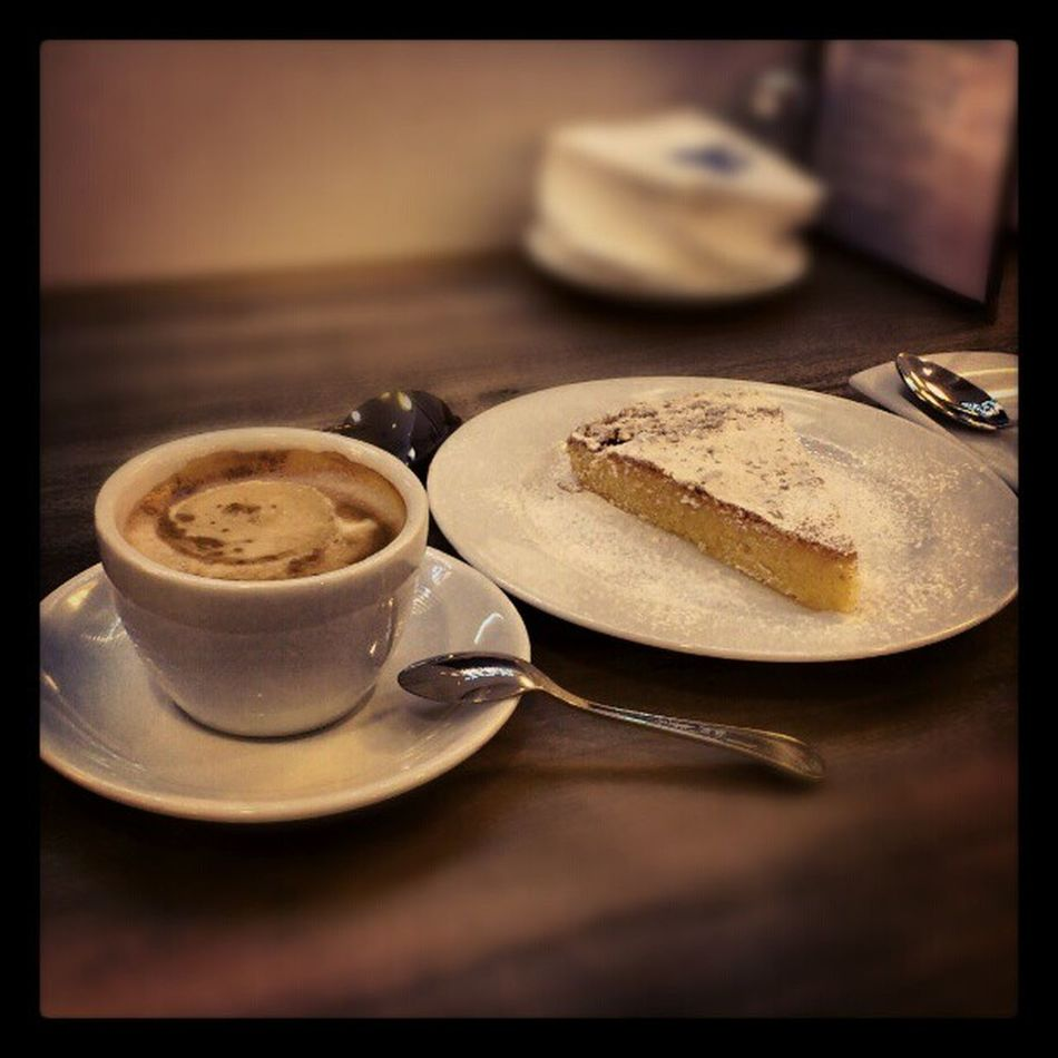 Enjoying an Early Breakfast of Delicious almond cake and cafe con leche at purto_banus el_Corte_ingles cafeteria marbella spain