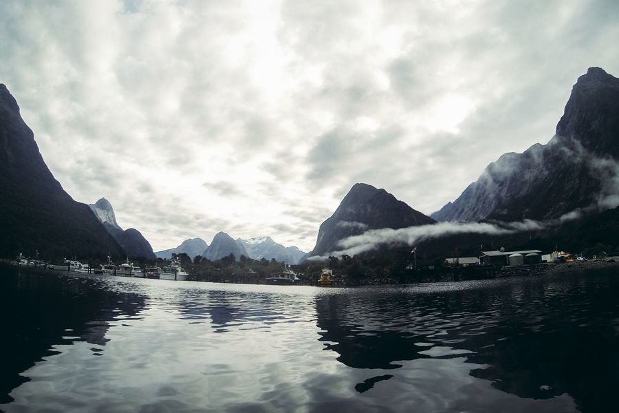 Adventure Beauty In Nature Calm Cloud Cloudy Fjord Idyllic Kayaking Lake Majestic Milford Sound Mountain Mountain Range Nature New Zealand Outdoors Overcast Reflection Scenics Sky Tranquil Scene Tranquility Water Waterfront Weather
