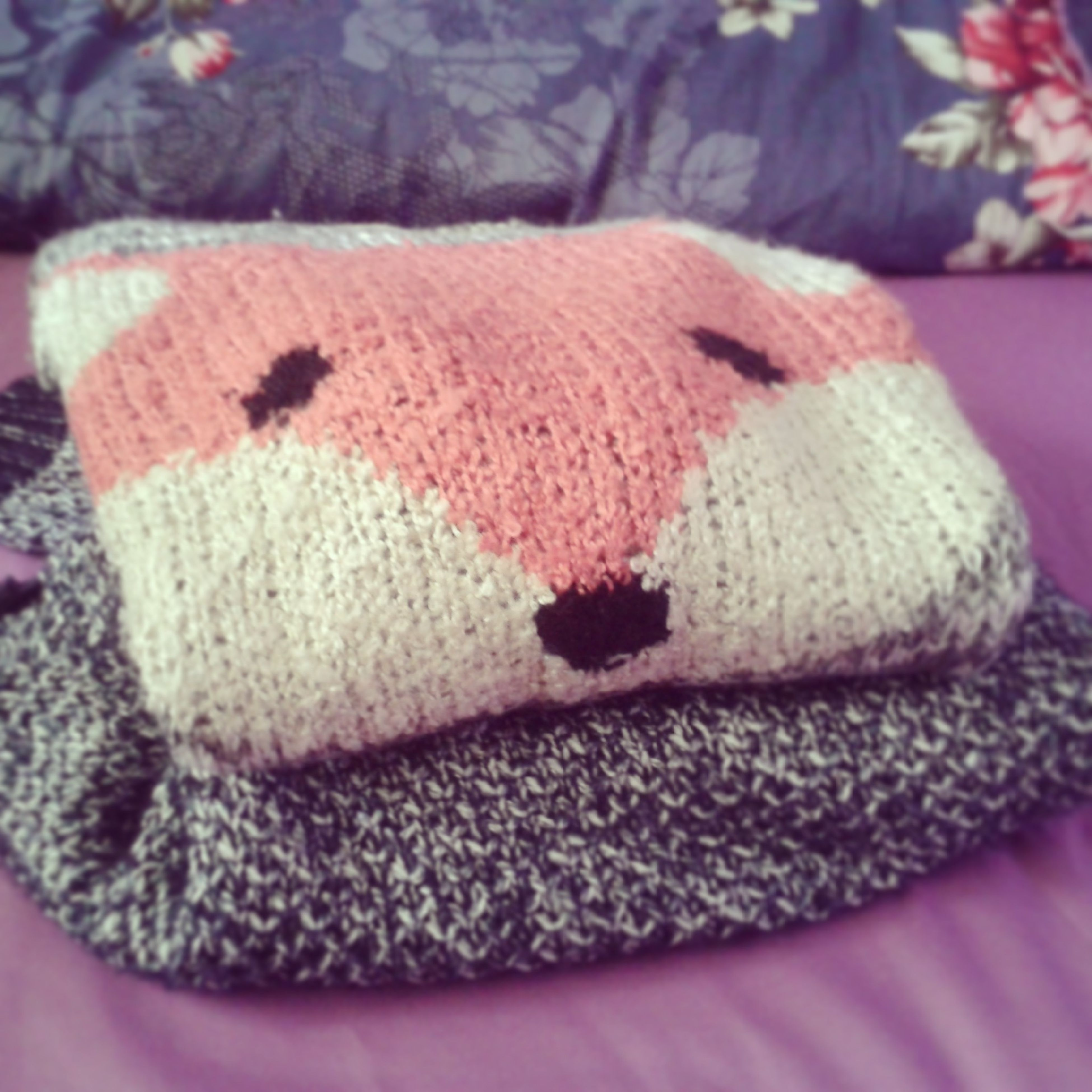 close-up, indoors, focus on foreground, fabric, pink color, stuffed toy, wool, still life, textile, toy, selective focus, no people, animal representation, softness, relaxation, bed, pattern, blanket, day, art and craft