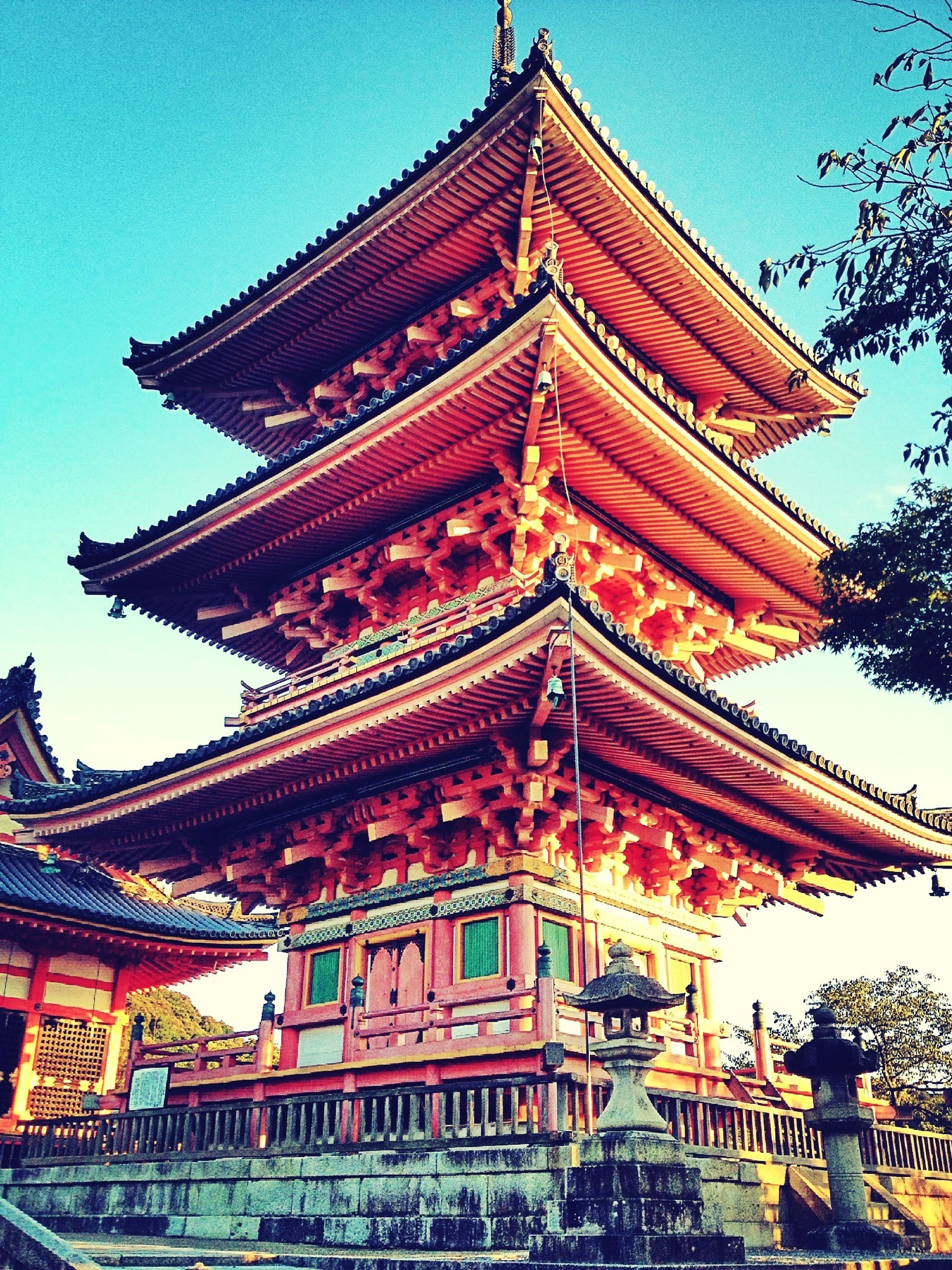 low angle view, architecture, built structure, building exterior, place of worship, religion, spirituality, temple - building, temple, famous place, ornate, clear sky, travel destinations, tradition, pagoda, sky, tourism, cultures, travel