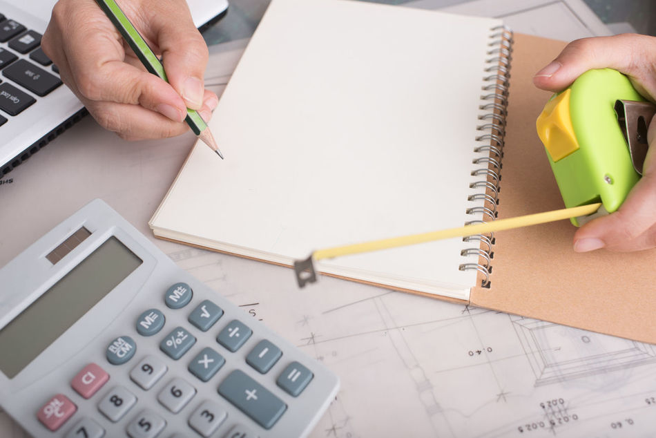 Calculator Close-up Drawing - Activity High Angle View Holding Human Body Part Human Finger Human Hand Indoors  Lifestyles Men Note Pad Occupation One Person Paper Pen Pencil Plan Real People Ruler Sketch Sketch Pad Table Working Writing