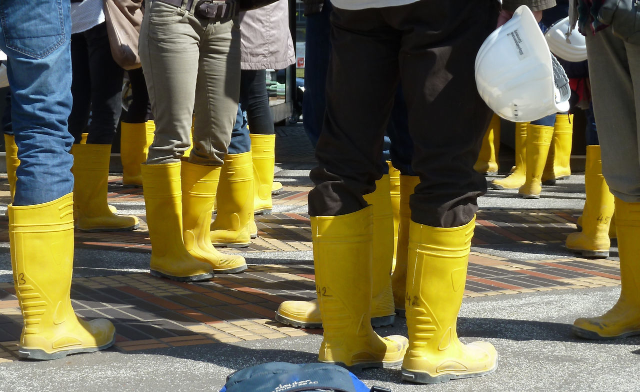 Boot Casual Clothing Front View Group Of People Hard Hat Helmet Human Foot In A Row Lifestyles LINE Low Section Outdoors Person Standing The Color Of Business Vibrant Color Yellow Rubber Boots