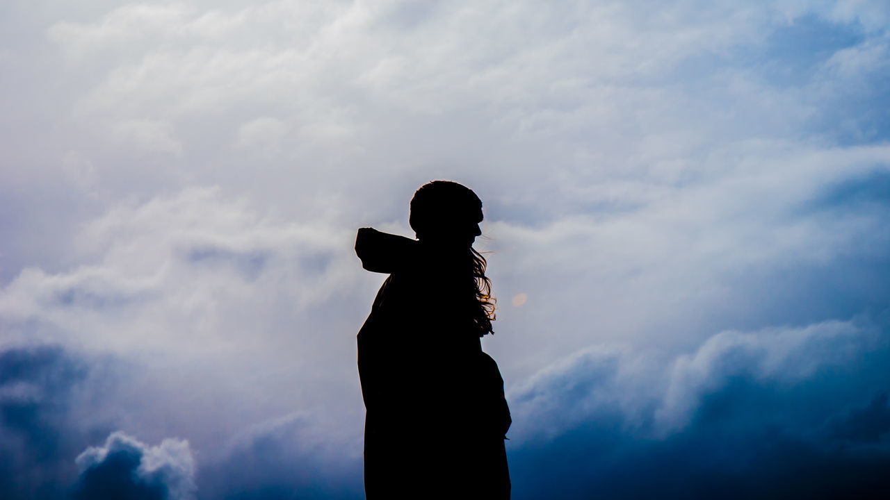 Cloud - Sky Day Human Hand Leisure Activity Low Angle View Men Nature One Person Outdoors People Real People Silhouette Sky Standing Statue Women