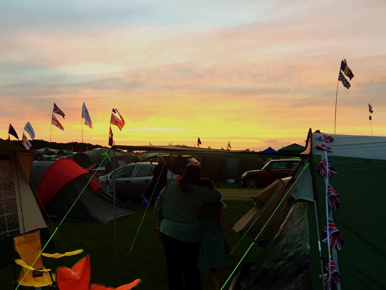 Live For The Story setting up camp for the weekend. Sunset Real People Flag Sunset Lifestyles Rear View Sky Leisure Activity Women Nature Cloud - Sky Outdoors Beauty In Nature Day People