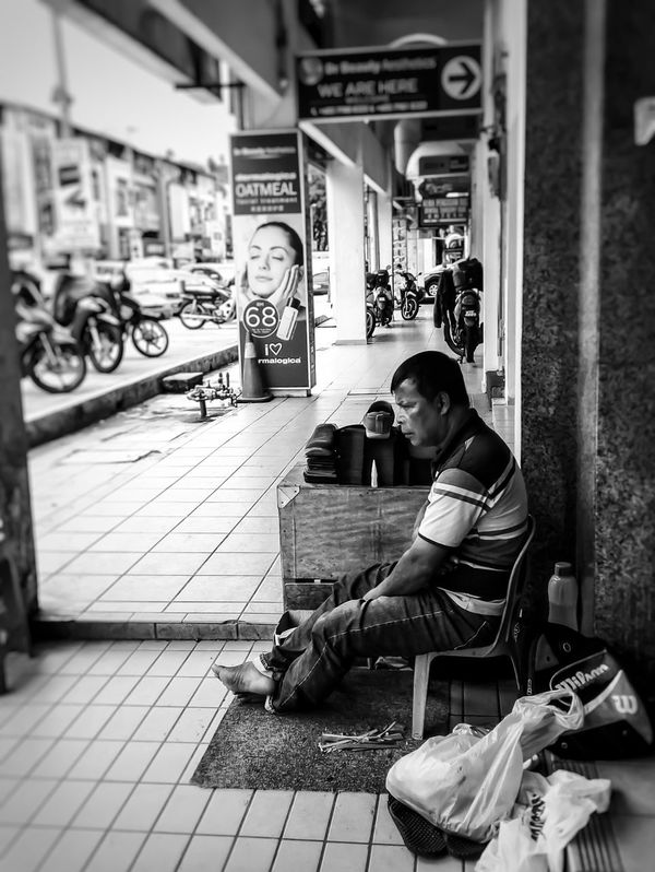 Person Focus On Foreground Urban Exploration Street Photography People Cobbler Waiting For Customers People And Places