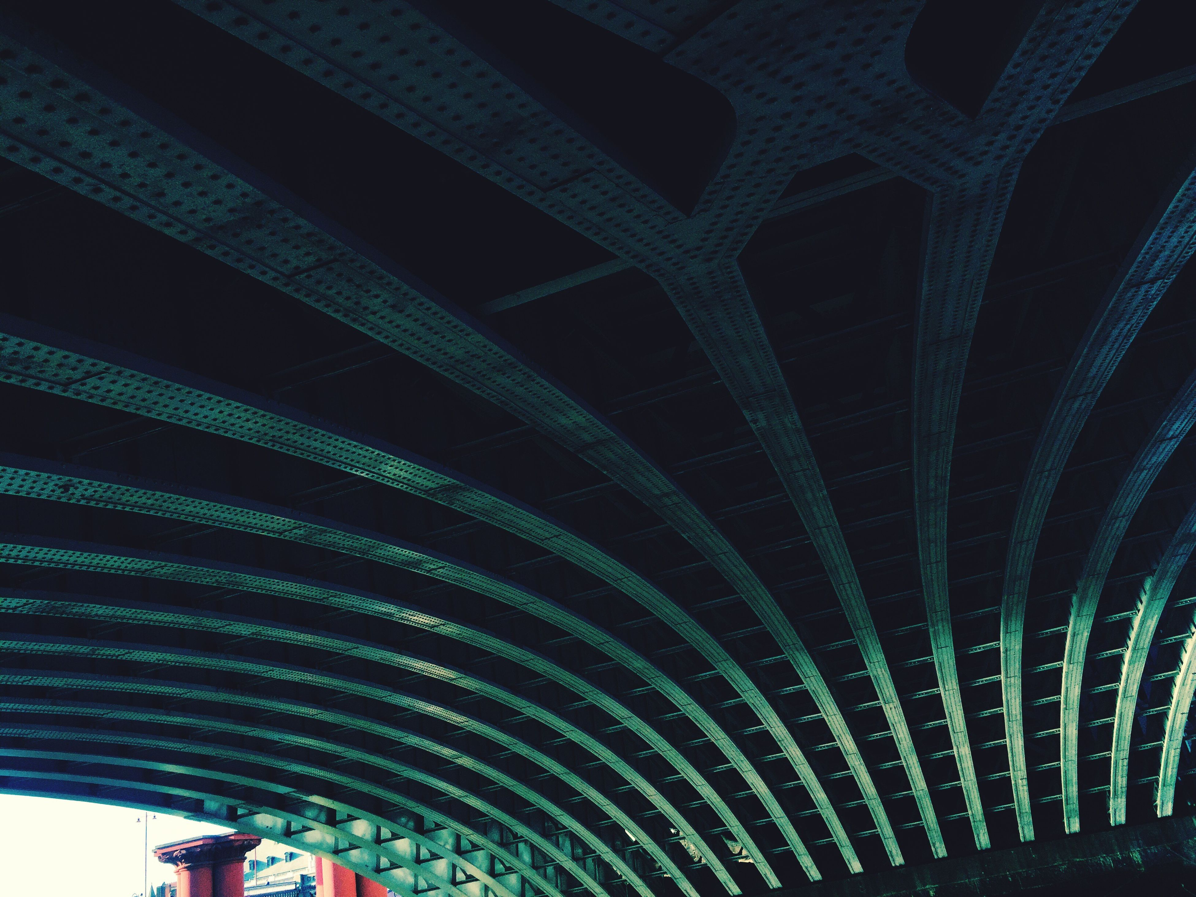 low angle view, night, illuminated, ceiling, architectural feature, modern, dark, below, tall, green color
