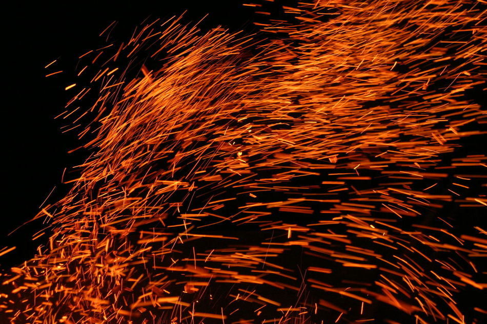 Black Background Burning Close-up Exploding Fire Flame Glowing Heat - Temperature Molten Motion Nature Night No People Outdoors Sparks Sparks Fly Sparks Flying