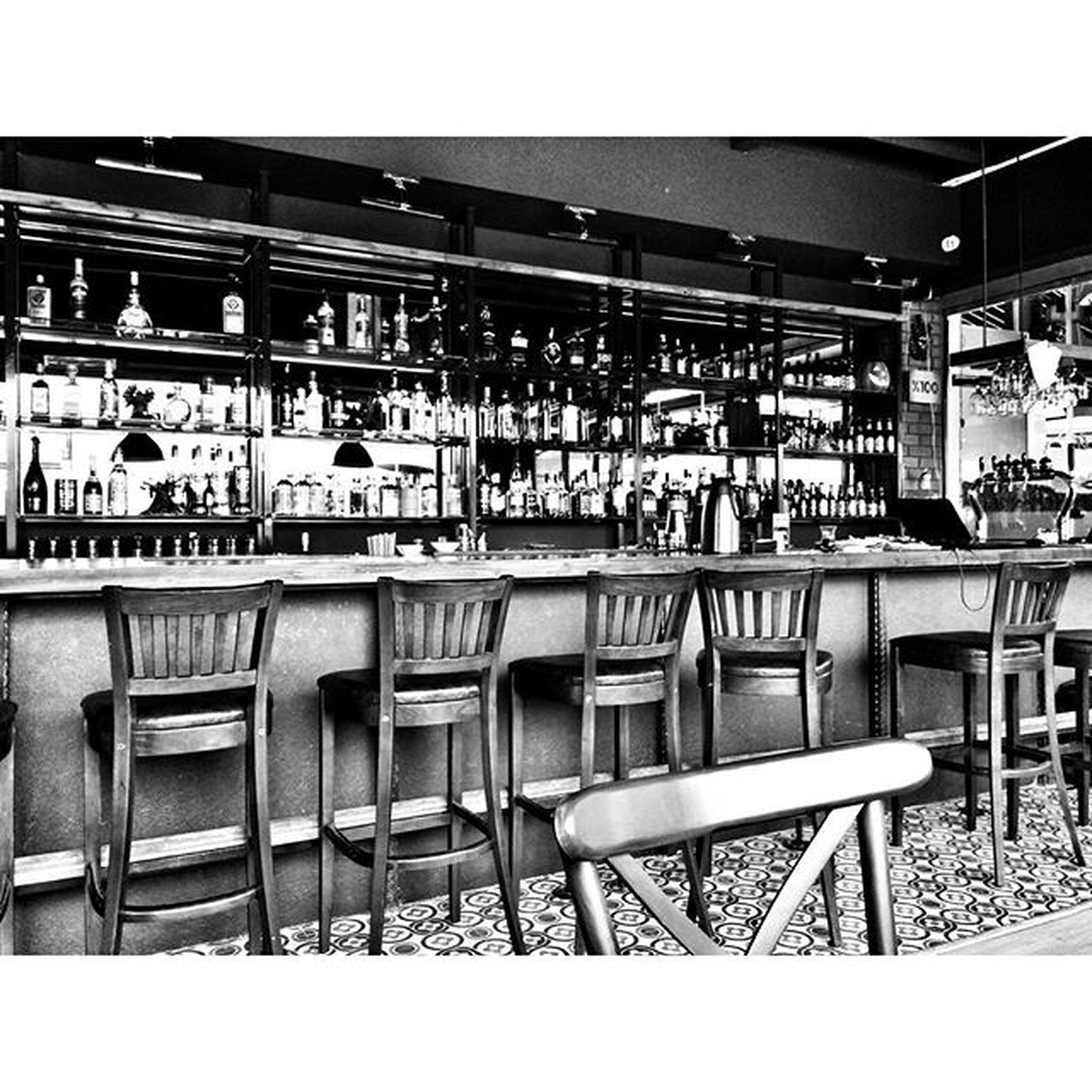 transfer print, chair, auto post production filter, indoors, in a row, empty, arrangement, absence, table, restaurant, seat, large group of objects, built structure, order, architecture, side by side, window, shelf, repetition, group of objects