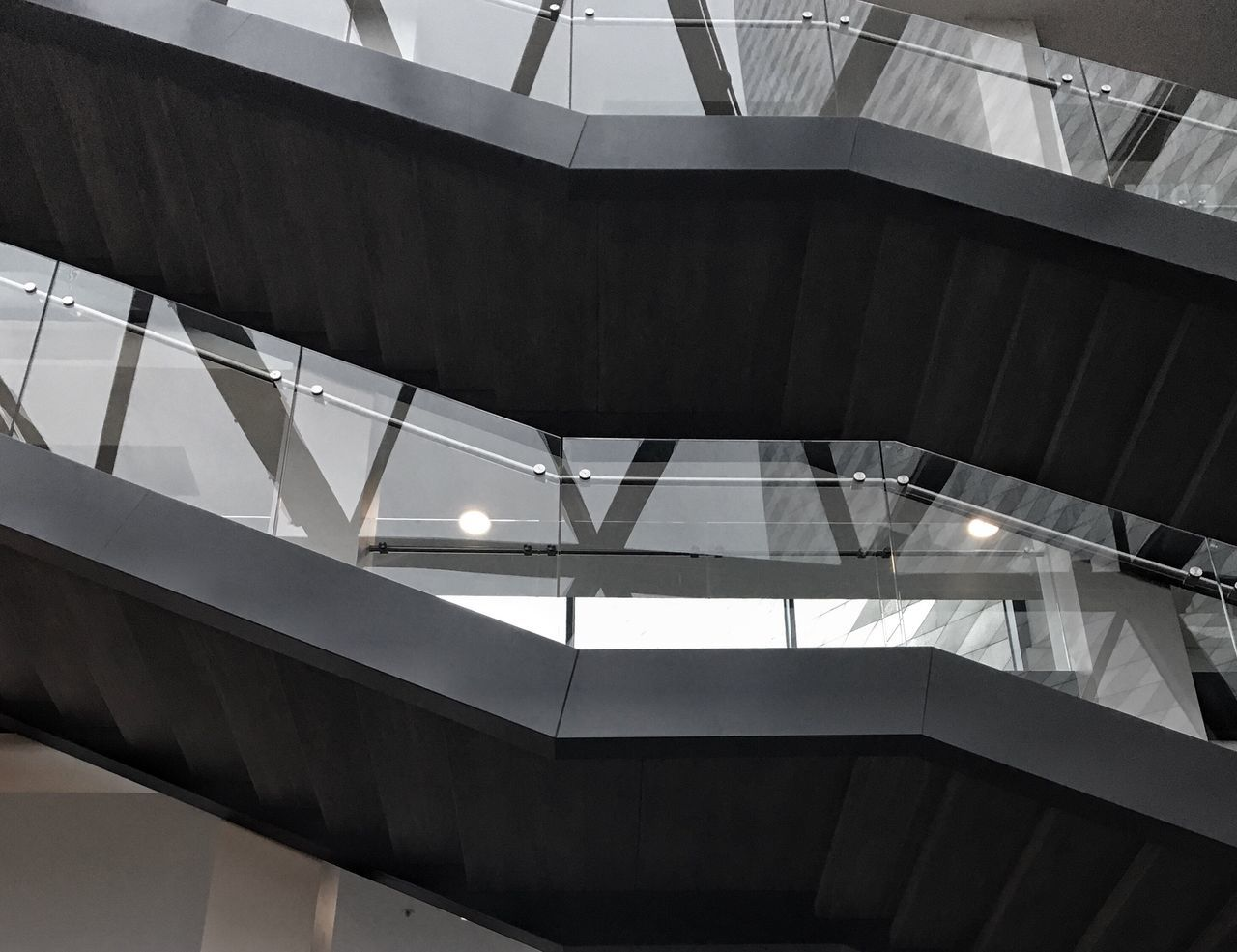 Built Structure Architecture Modern Interior Design Interior Low Angle View Indoors  No People Stairways Day Elevated Walkway Bank Building Built Structures Design Staircase Lines And Shapes Lines Lines&Design Office Building Modern Building Black Reflections Geometry Glass