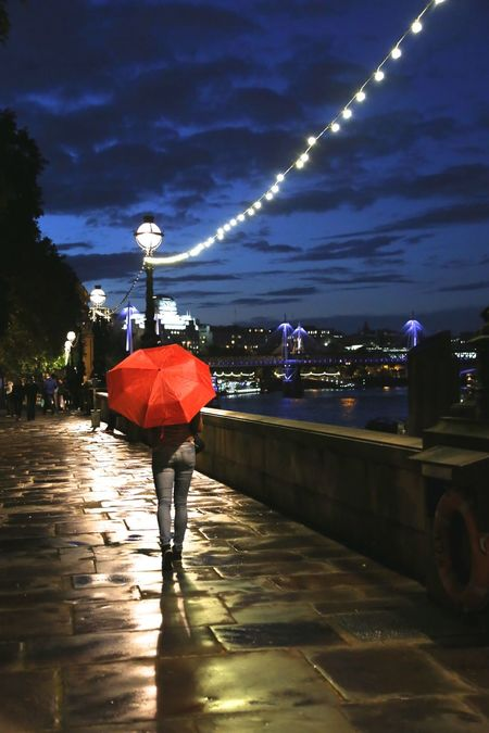 EyeEm LOST IN London Architecture Bridge - Man Made Structure Building Exterior Built Structure City Full Length Illuminated Lifestyles Night One Person Outdoors Real People Rear View Redumbrella Sky Travel Destinations Umbrella Walking Water Women