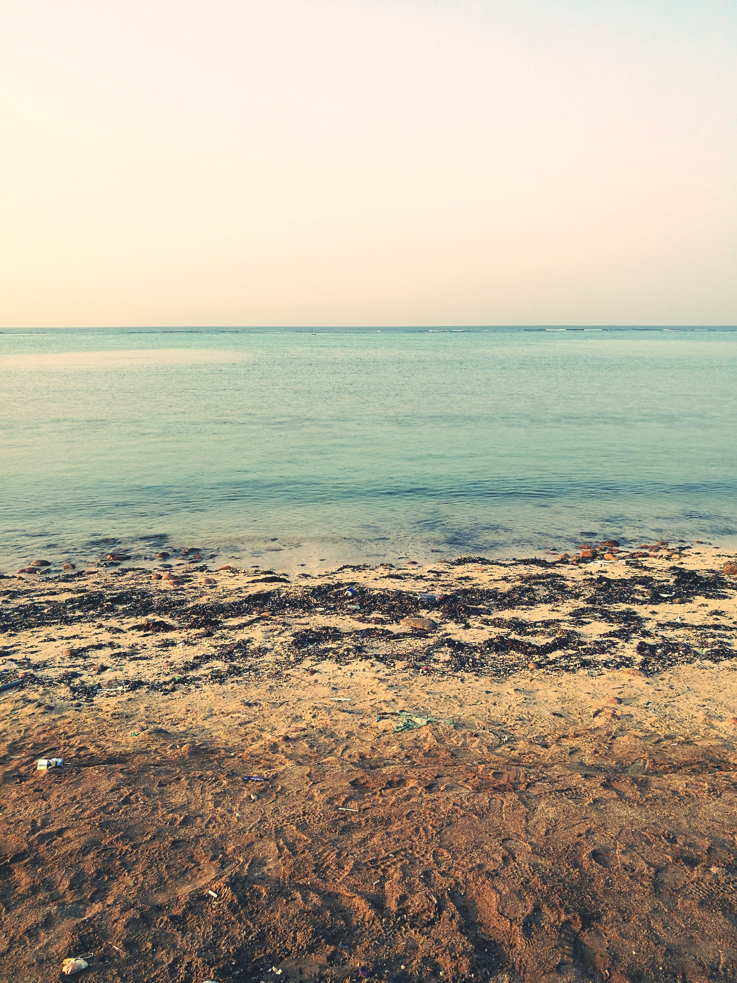 sea, nature, horizon over water, beach, scenics, clear sky, beauty in nature, water, sky, tranquil scene, tranquility, outdoors, no people, day, sand