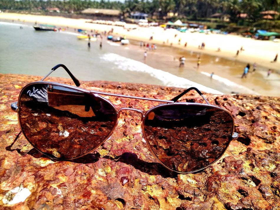 EyeEmNewHere Beach Water Close-up Sand Outdoors Sea No People Day Rayban Aviators City Goa Travel High Angle View Travel Destinations Built Structure Neverhide