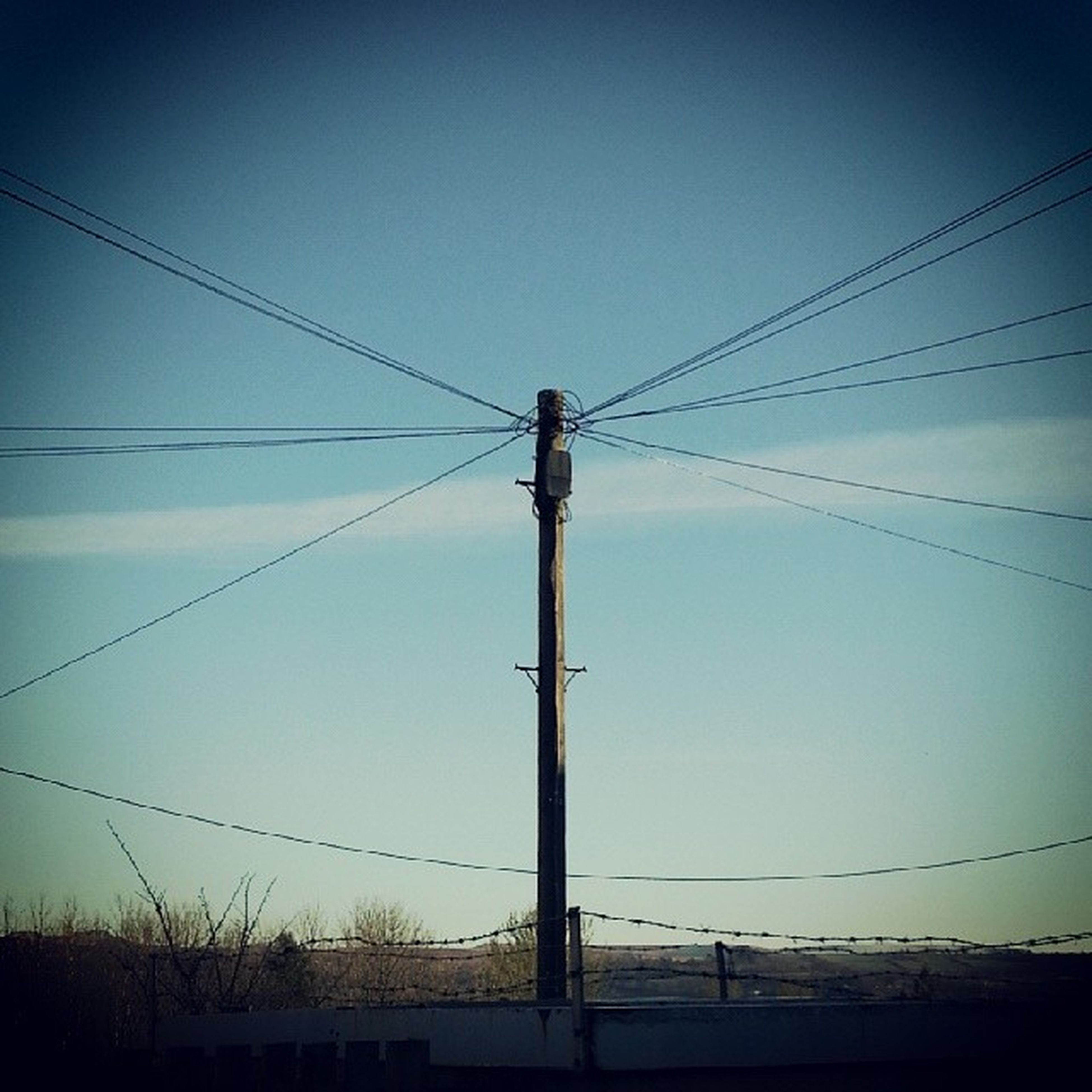 power line, power supply, electricity, electricity pylon, cable, connection, fuel and power generation, low angle view, technology, power cable, clear sky, blue, sky, silhouette, pole, outdoors, copy space, no people, telephone line, telephone pole