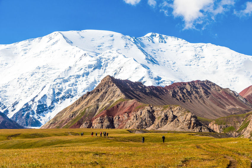 Hiking Kyrgyzstan Pamir Mountains Trekking Beauty In Nature Cold Temperature Day Grass Landscape Mountain Mountain Range Nature Outdoors Pamir Range Scenics Sky Snow Snowcapped Mountain Tranquil Scene Tranquility Travel Destinations