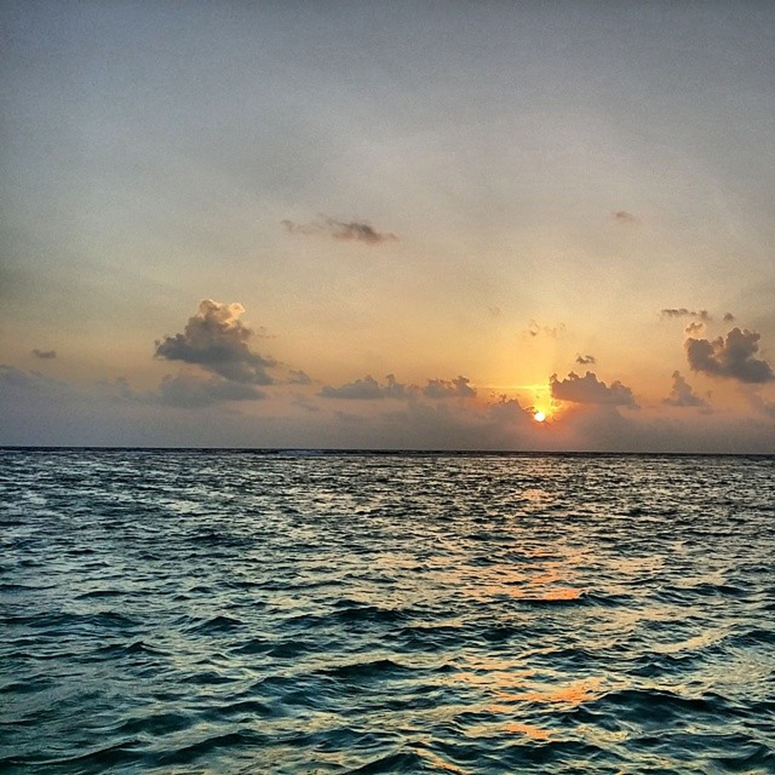 sea, water, sunset, horizon over water, scenics, tranquil scene, beauty in nature, tranquility, waterfront, sun, sky, rippled, nature, idyllic, orange color, sunlight, reflection, outdoors, seascape, cloud - sky