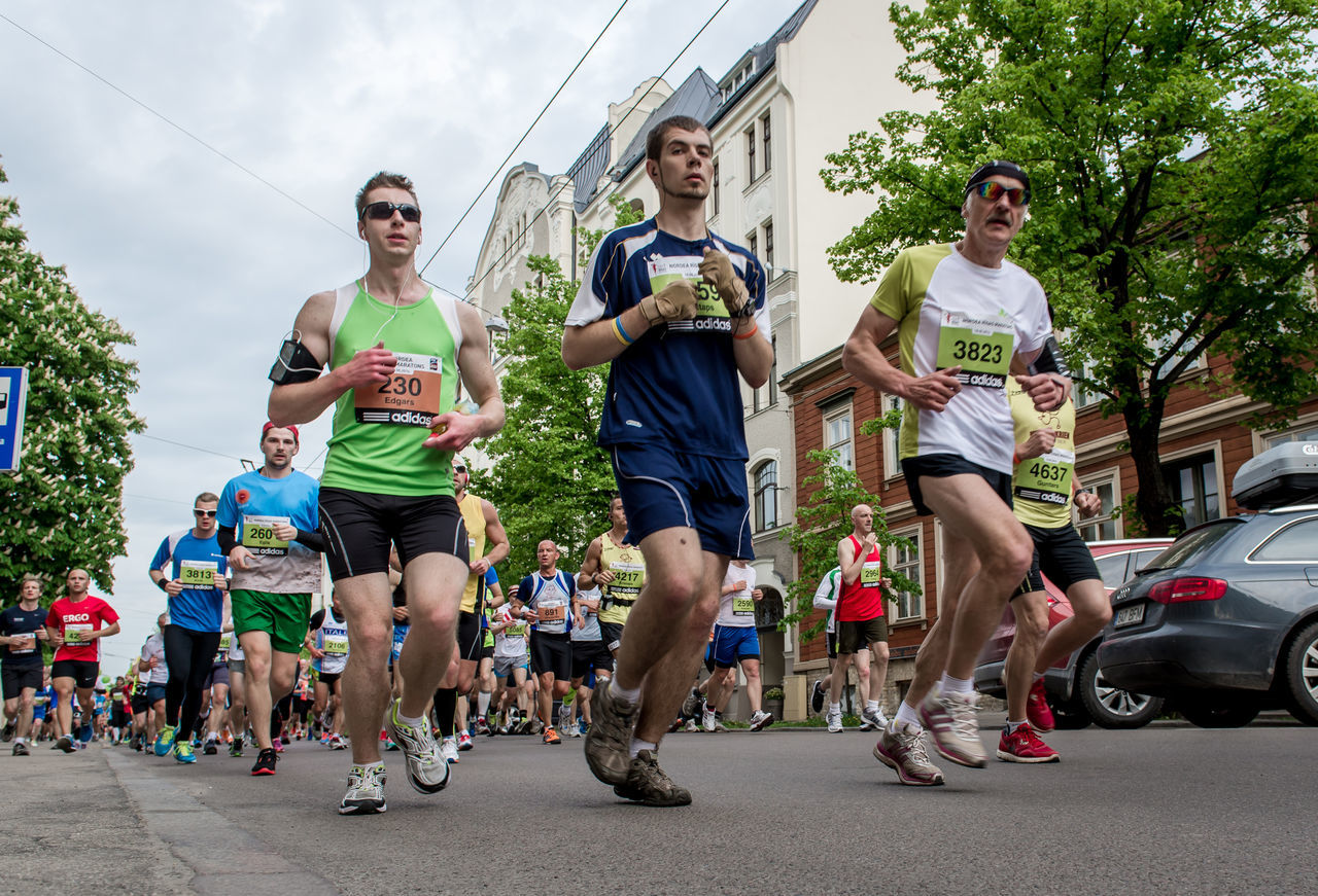LATVIA, RIGA - 18 may, 2014: The 24th Nordea Riga marathon,at this time the marathon gained international recognition and previous marathon on 2013 gathered 22020 runners from 65 countries on 18 may 2014 2014 Adults Only Competition Crowd Of People Day Distance Editorial  Endurance Human Joggers Latvia Riga Many People Marathon Marathon Runner Northern Europe Outdoors Reportage Riga Latvia Road Run Runners Sport Sportive Street Summer