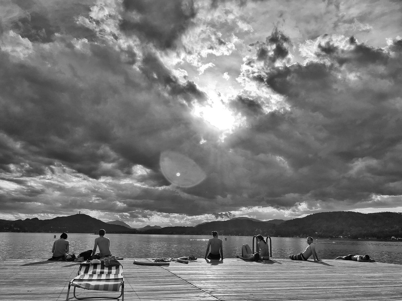 cloud - sky, sky, water, nature, mountain, beauty in nature, outdoors, real people, scenics, day, men, nautical vessel, people