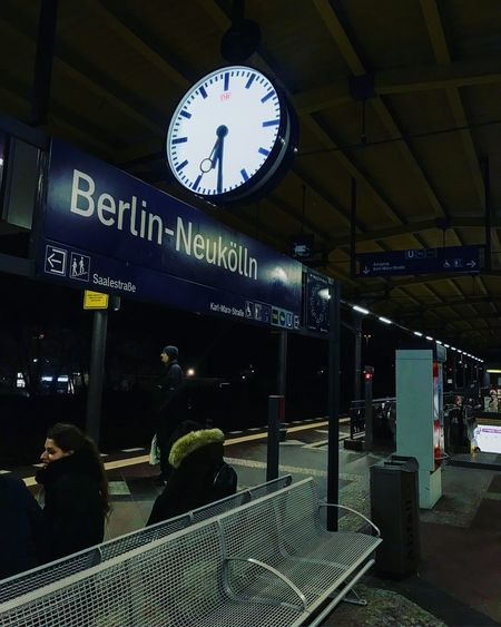 Railroad Station Railroad Station Platform Communication Text Time Public Transportation Transportation Clock Built Structure Illuminated Transportation Building - Type Of Building Real People Technology Men Night Clock Face Minute Hand People