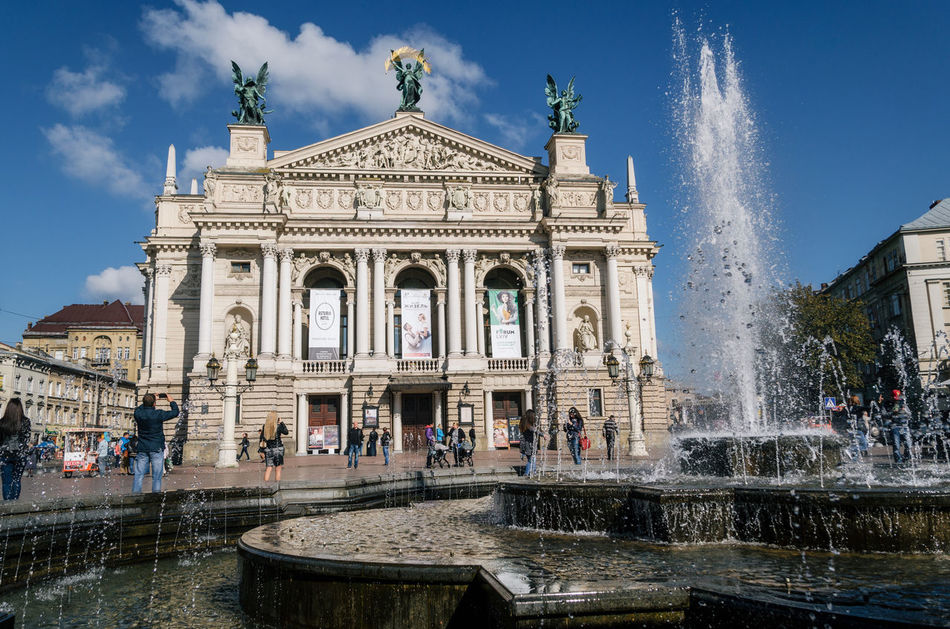 National Academic Opera and Ballet Theater named Krushelnytska with fountain and tourists, Lviv, Ukraine Architecture Building Exterior Built Structure City Cloud - Sky Day Fountain Large Group Of People Lviv Motion Operahouse Outdoors Spraying Theater Travel Destinations Ukraine Vacations