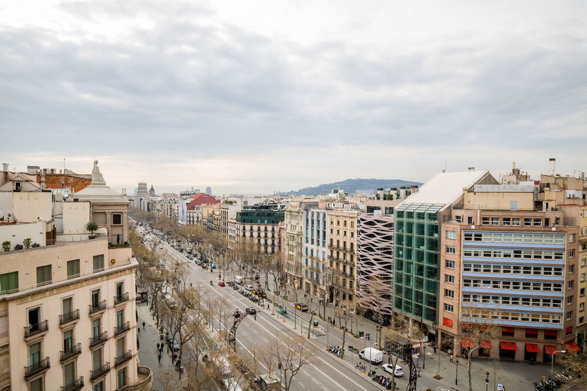 Architecture City Travel Destinations Building Exterior High Angle View Urban Skyline Built Structure Sky Cityscape Business Finance And Industry Outdoors No People Day City Street Barcelona SPAIN Skyline Portrait Of A City Watching Over A City Horizontal Cityscape Aerial View In Line